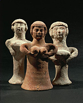 Three Astarte figurines, supporting their breasts with hands. From Judah. Terracotta, pillar-type (1000-700 BCE) Iron Age